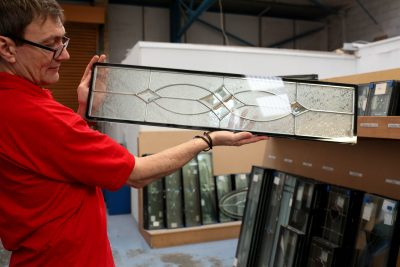 Bob Stocker of Double R's Decorative Centre of Excellence displaying one of the many decorative panels Double R supplies.