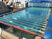 Toughened glass is prepared for the sealing line by protecting the coated side